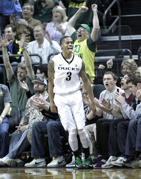 Oregon guard Joseph Young celebrates with the crowd after sinking a three point shot during the second half of an NCAA college basketball game against Arizona State in Eugene, Ore., Tuesday, March 4, 2014.  Young scored 13 points as they beat Arizona State 85-78
