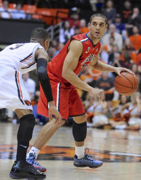 Arizona's Nick Johnson (13) works against Oregon State's Hallice Cooke (3) during the first half of an NCAA college basketball game in Corvallis, Ore., Wednesday March 5, 2014