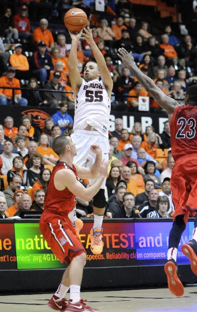 Arizona's TJ McConnell (4) and Rondae Hollis-Jefferson (23) defend a shot by Oregon State's Roberto Nelson (55) during the second half of an NCAA college basketball game in Corvallis, Ore., Wednesday March 5, 2014. Arizona beat Oregon State 74-69 in a game that was tied 10 times