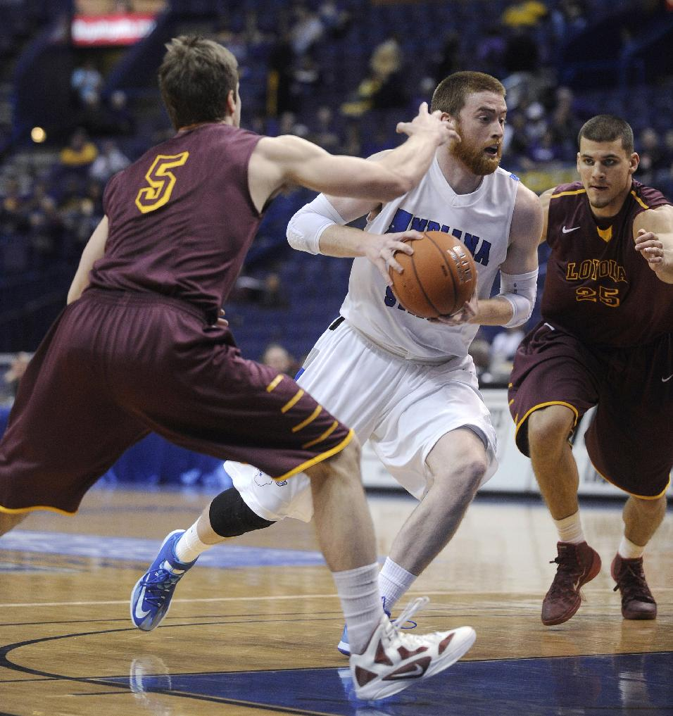 Indiana State's Justin Gant, center, drives between Loyola of Chicago's Joe Crisman (5) and Nick Osborne (25) during the first half of an NCAA college basketball game in the quarterfinals of the Missouri Valley Conference men's tournament, Friday, March 7, 2014, in St. Louis