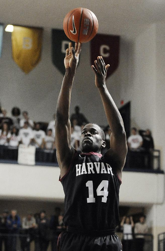 Harvard's Steve Moundou-Missi shoots during the first half of an NCAA college basketball game against Yale, Friday, March 7, 2014, in New Haven, Conn
