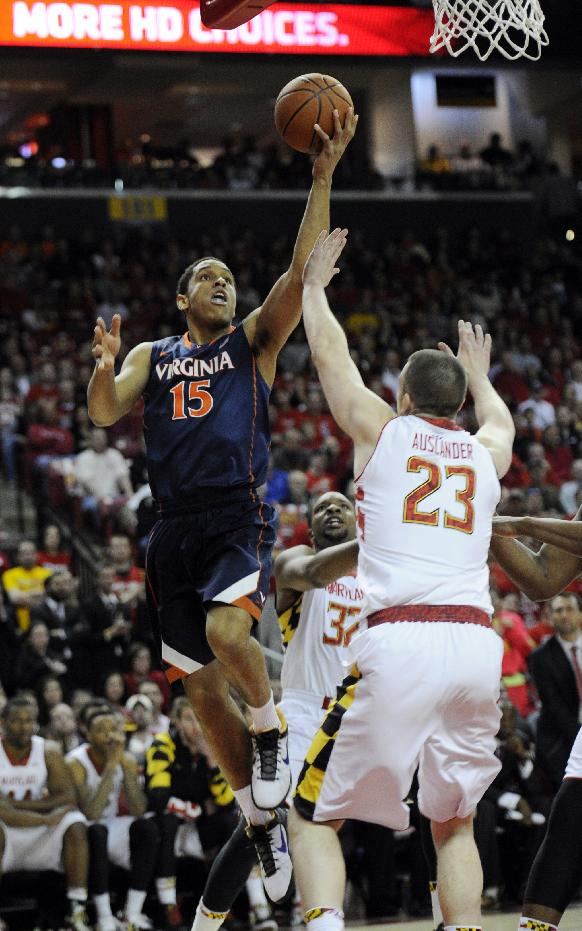 Virginia guard Malcolm Brogdon (15) goes to the basket against Maryland forward John Auslander (23) during the first half of an NCAA college basketball game, Sunday, March 9, 2014, in College Park, Md