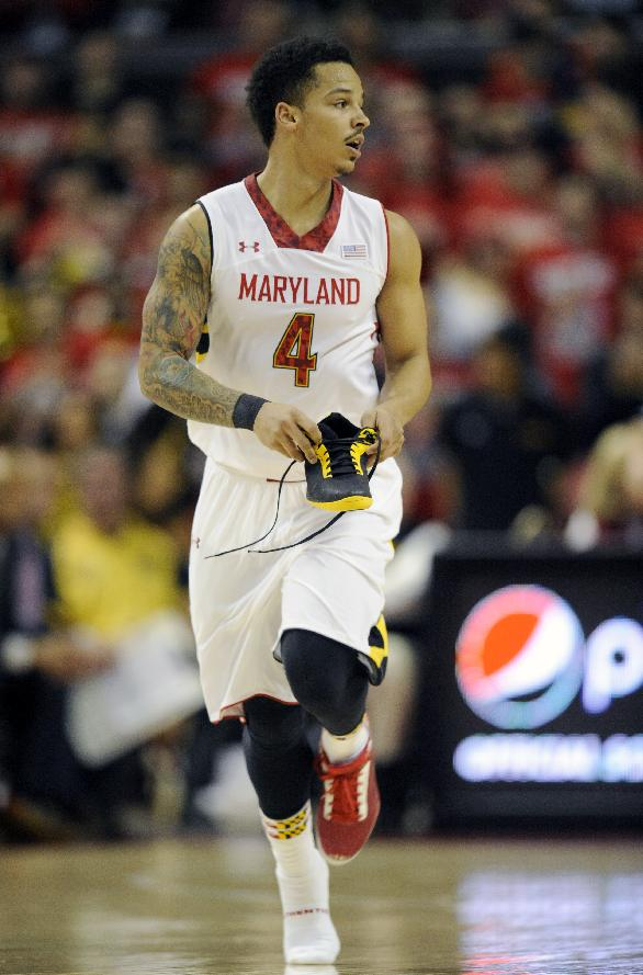 Maryland guard Seth Allen (4) carrys his shoe down the court after it came off during the first half of an NCAA college basketball game against Virginia, Sunday, March 9, 2014, in College Park, Md
