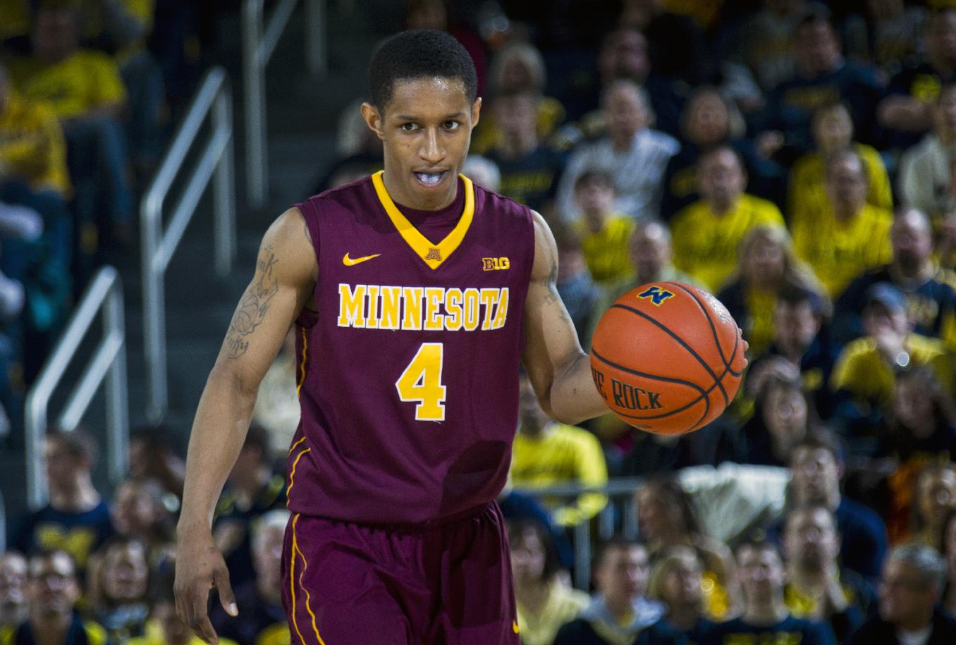 In this March 1, 2014 file photo, Minnesota guard Deandre Mathieu (4) dribbles the ball in the second half of an NCAA college basketball game against Michigan in Ann Arbor, Mich. Minnesota enters the Big Ten tournament needing a win or two to secure that elusive NCAA tournament berth, and the fate of the Gophers will rest largely on the small shoulders of Mathieu