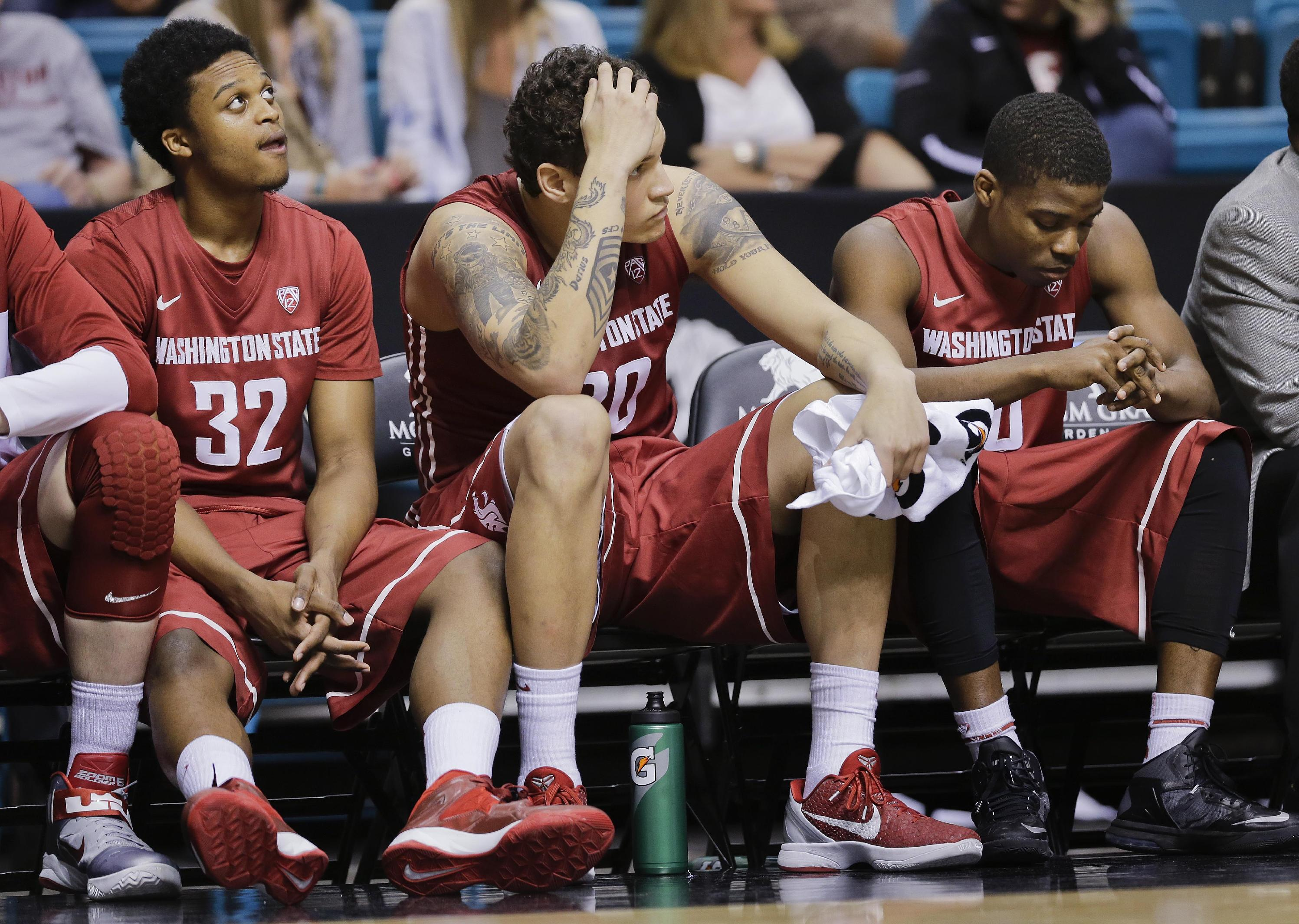 From left, Washington State's Que Johnson, Jordan Railey and Ike Iroegbu watch play from the bench late in the second half of an NCAA Pac-12 conference tournament college basketball game against Stanford, Wednesday, March 12, 2014, in Las Vegas. Stanford won 74-63