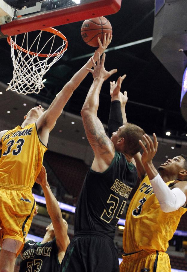 UC Irvine forward Mike Best (33) reaches for a rebound against Cal Poly forward Brian Bennett, center, and Irvine forward Will Davis II (3) during the first half of an NCAA college basketball game of the Big West Conference men's tournament in Anaheim, Calif., Friday, March 14, 2014
