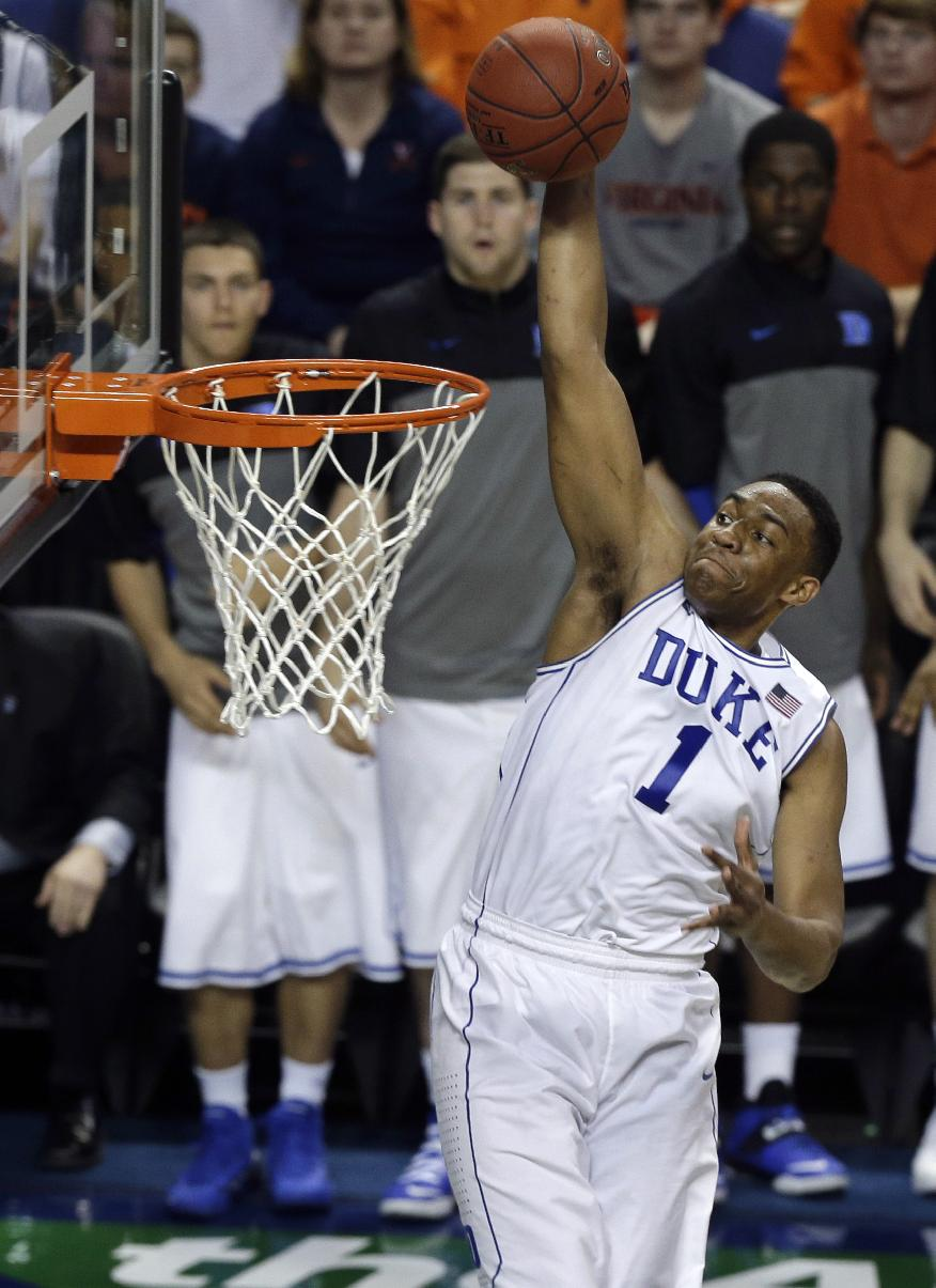 Duke's Jabari Parker (1) goes up to dunk against North Carolina State during the second half of an NCAA college basketball game in the semifinals of the Atlantic Coast Conference tournament in Greensboro, N.C., Saturday, March 15, 2014.  Duke won 75-67