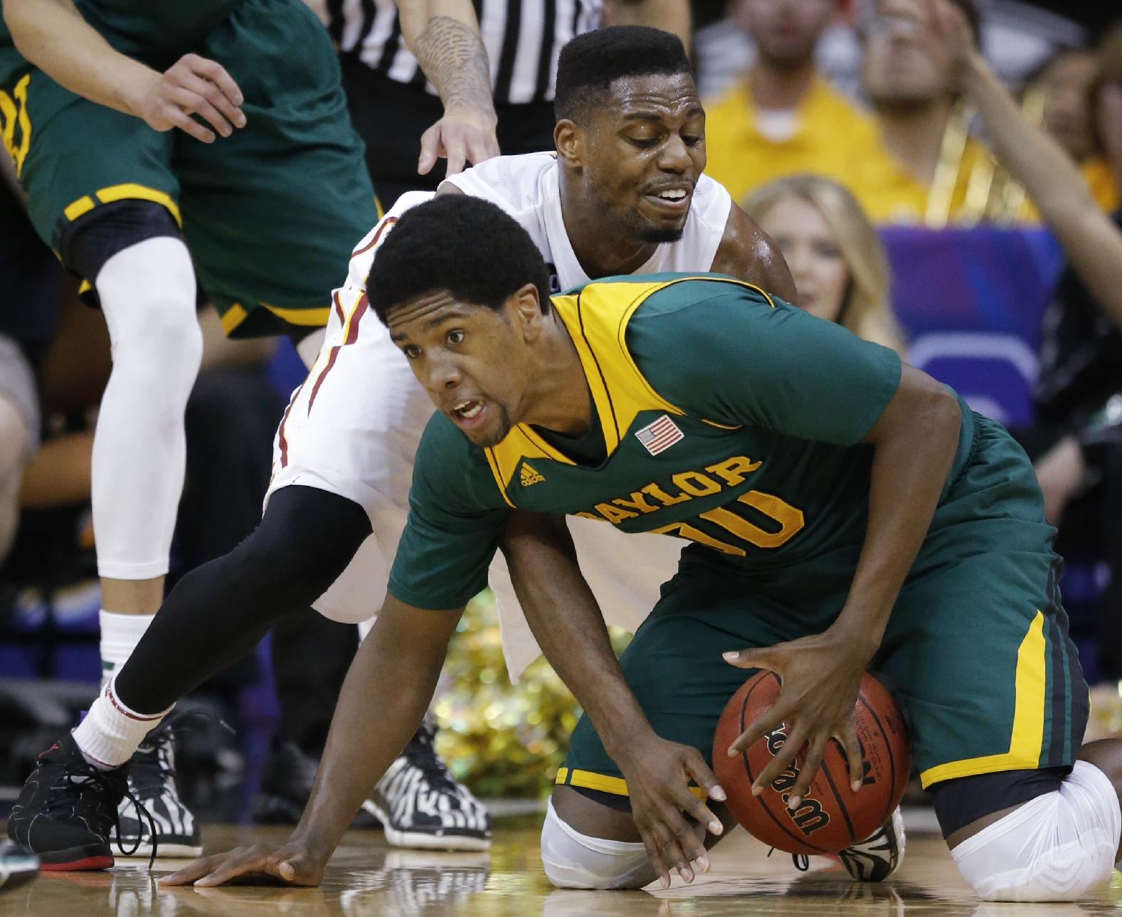 Baylor forward Royce O'Neale (00) gathers the ball while covered by Iowa State forward Melvin Ejim, back, during the first half of an NCAA college basketball game in the final of the Big 12 Conference men's tournament in Kansas City, Mo., Saturday, March 15, 2014