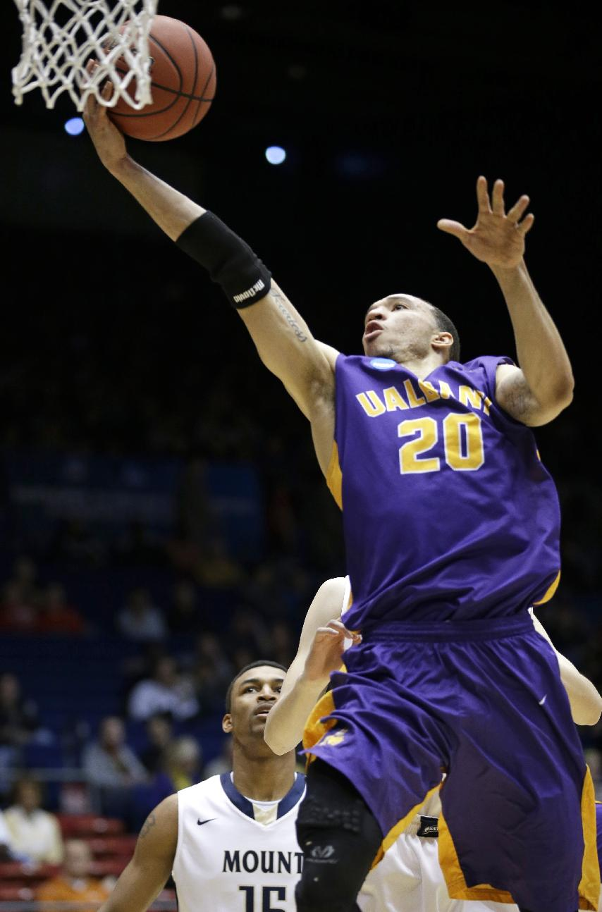 Albany forward Gary Johnson drives against Mount St. Mary's in the first half of a first-round game of the NCAA college basketball tournament, Tuesday, March 18, 2014, in Dayton, Ohio