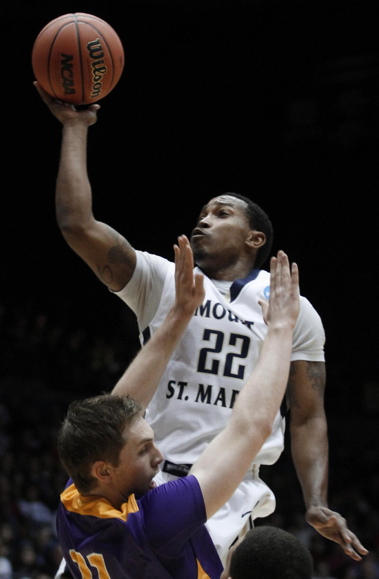 Mount St. Mary's guard Rashad Whack (22) shoots over Albany forward Luke Devlin in the first half of a first-round game of the NCAA college basketball tournament, Tuesday, March 18, 2014, in Dayton, Ohio