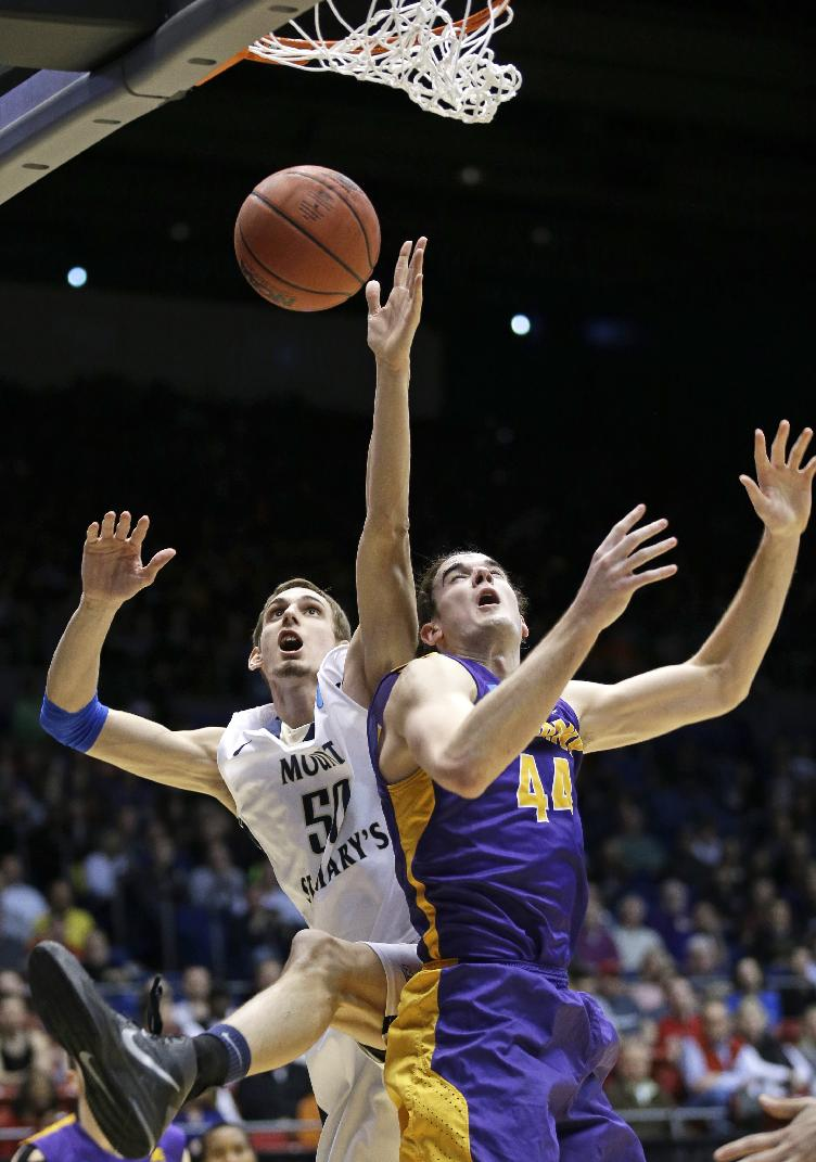 Mount St. Mary's center Taylor Danaher (50) goes up for a rebound against Albany center John Puk (44) in the second half of a first-round game of the NCAA college basketball tournament, Tuesday, March 18, 2014, in Dayton, Ohio