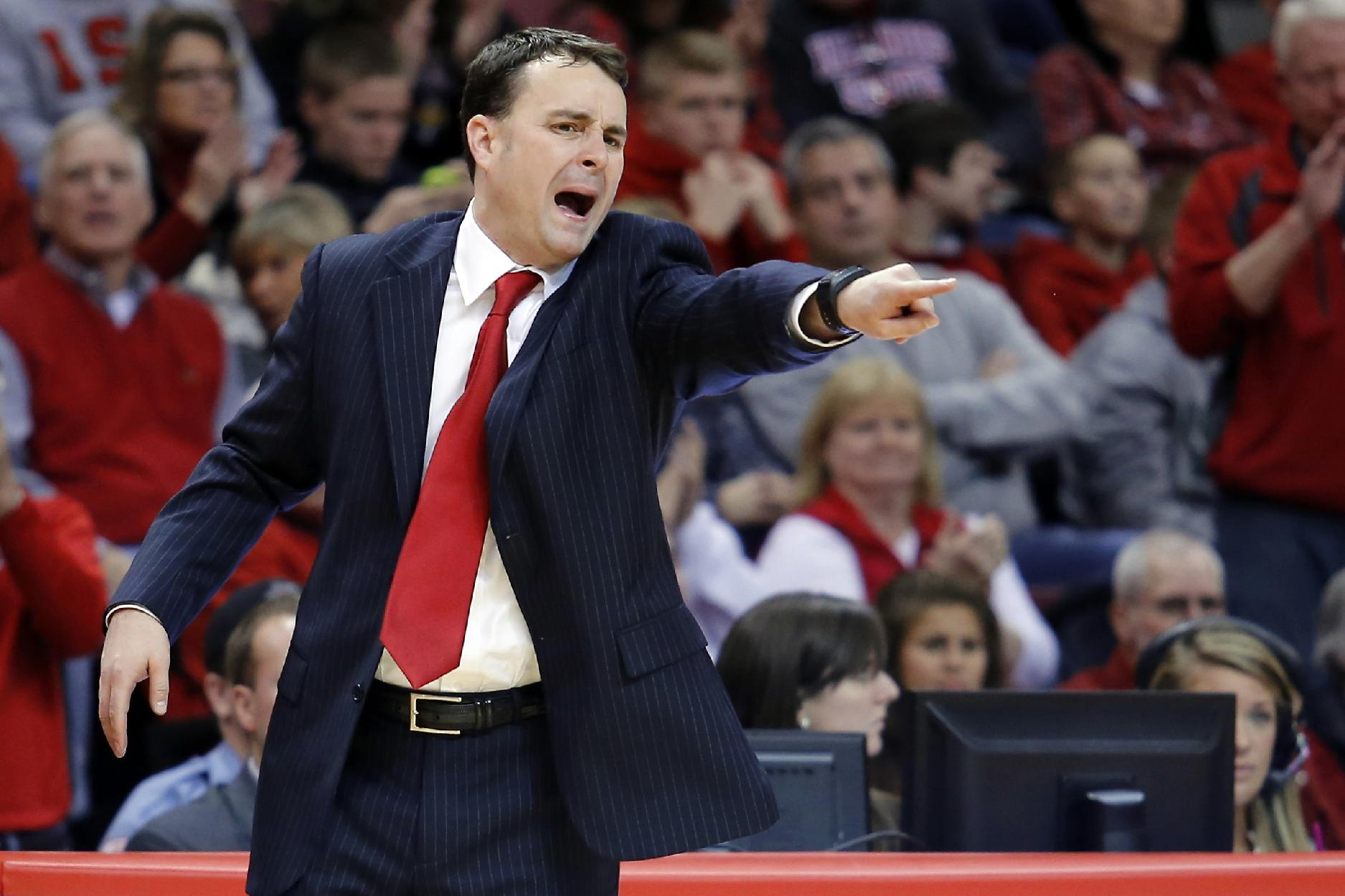 In this Dec. 7, 2013, file photo, Dayton coach Archie Miller calls out from the bench during an NCAA college basketball game against Illinois State in Normal, Ill. John Miller's sons _ Sean, who coaches No. 1 West seed Arizona; and younger brother Archie, who coaches No. 11 South seed Dayton _ could meet in the Final Four