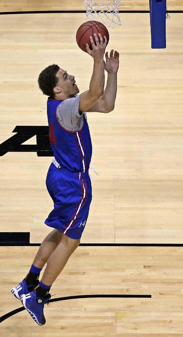 Kansas's Brannen Greene shoots during practice for the NCAA college basketball tournament Thursday, March 20, 2014, in St. Louis. Kansas is scheduled to play against Eastern Kentucky in a second-round game on Friday