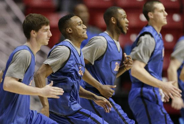 Tulsa guard James Woodard, second from left, runs a drill with teammates during practice at the NCAA college basketball tournament Thursday, March 20, 2014, in San Diego. Tulsa faces UCLA in a second-round game on Friday