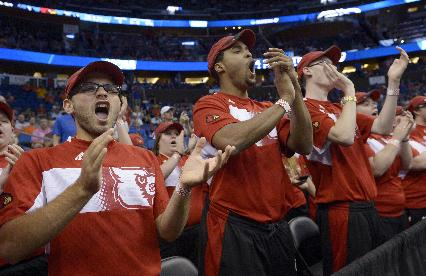 Louisville fans cheer during the first half in a third-round game in the NCAA college basketball tournament against Saint Louis, Saturday, March 22, 2014, in Orlando, Fla