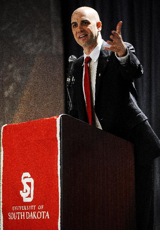 Former Nebraska assistant coach, Craig Smith, speaks during a news conference announcing Smith as the new South Dakota NCAA college basketball coach Monday, March 24, 2014, in Vermillion, S.D