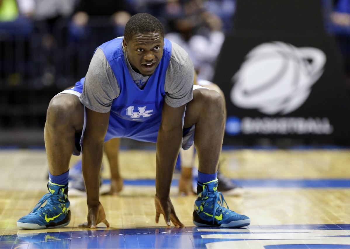 Kentucky's Julius Randle stretches during practice for their NCAA Midwest Regional semifinal college basketball tournament game Thursday, March 27, 2014, in Indianapolis. Kentucky plays Louisville on Friday, March 28, 2013