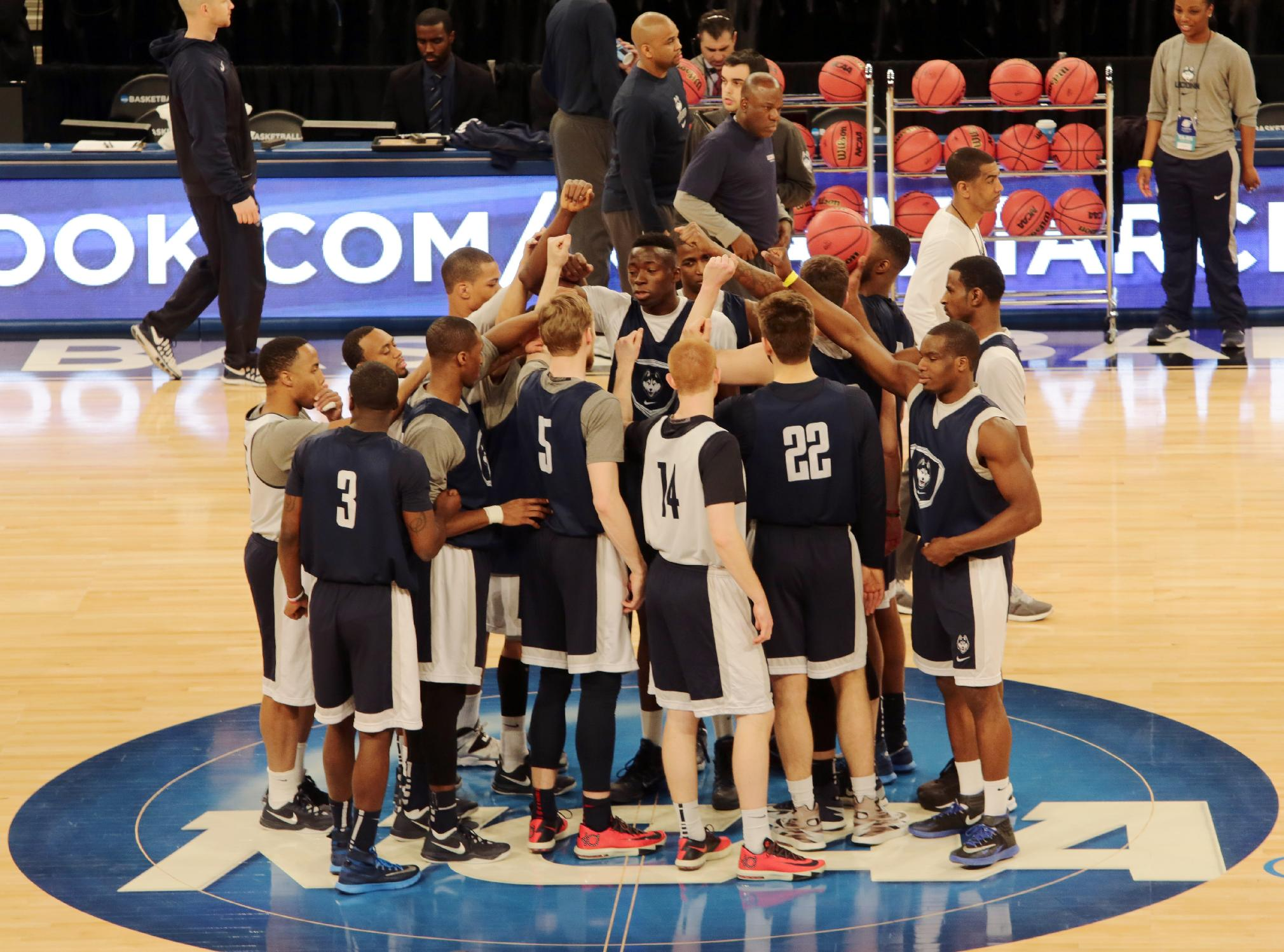 Connecticut players gather on the court at Madison Square Garden during practice at the NCAA college basketball tournament in New York, Thursday, March 27, 2014. Connecticut plays Iowa State in a regional semifinal on Friday