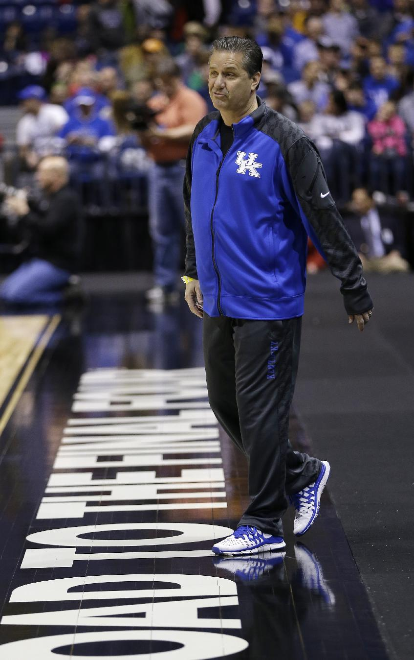 Kentucky head coach John Calipari walks around during practice for the NCAA Midwest Regional semifinal college basketball tournament game Thursday, March 27, 2014, in Indianapolis. Kentucky plays Louisville on Friday, March 28, 2013