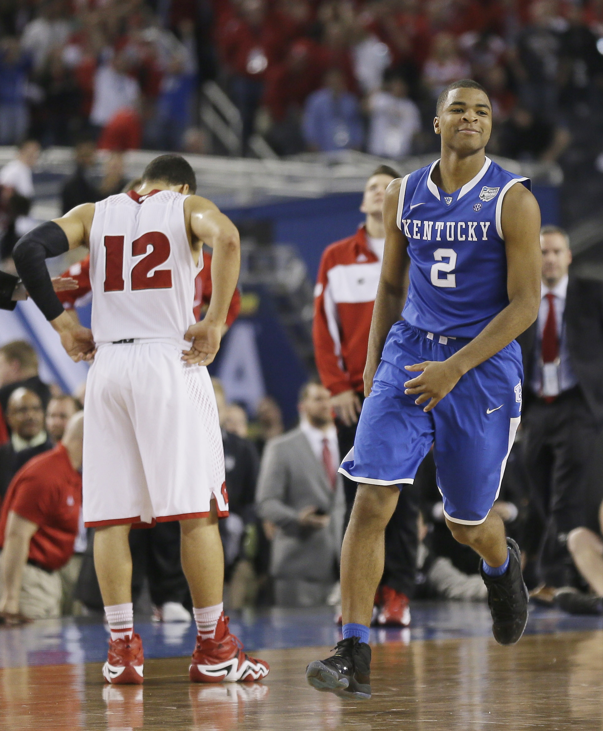 Kentucky guard Aaron Harrison (2) celebrates after making a three-point basket in the final seconds against Wisconsin to win the game 74-73 during their NCAA Final Four tournament college basketball semifinal game Saturday, April 5, 2014, in Arlington, Texas. Wisconsin guard Traevon Jackson (12) walks away
