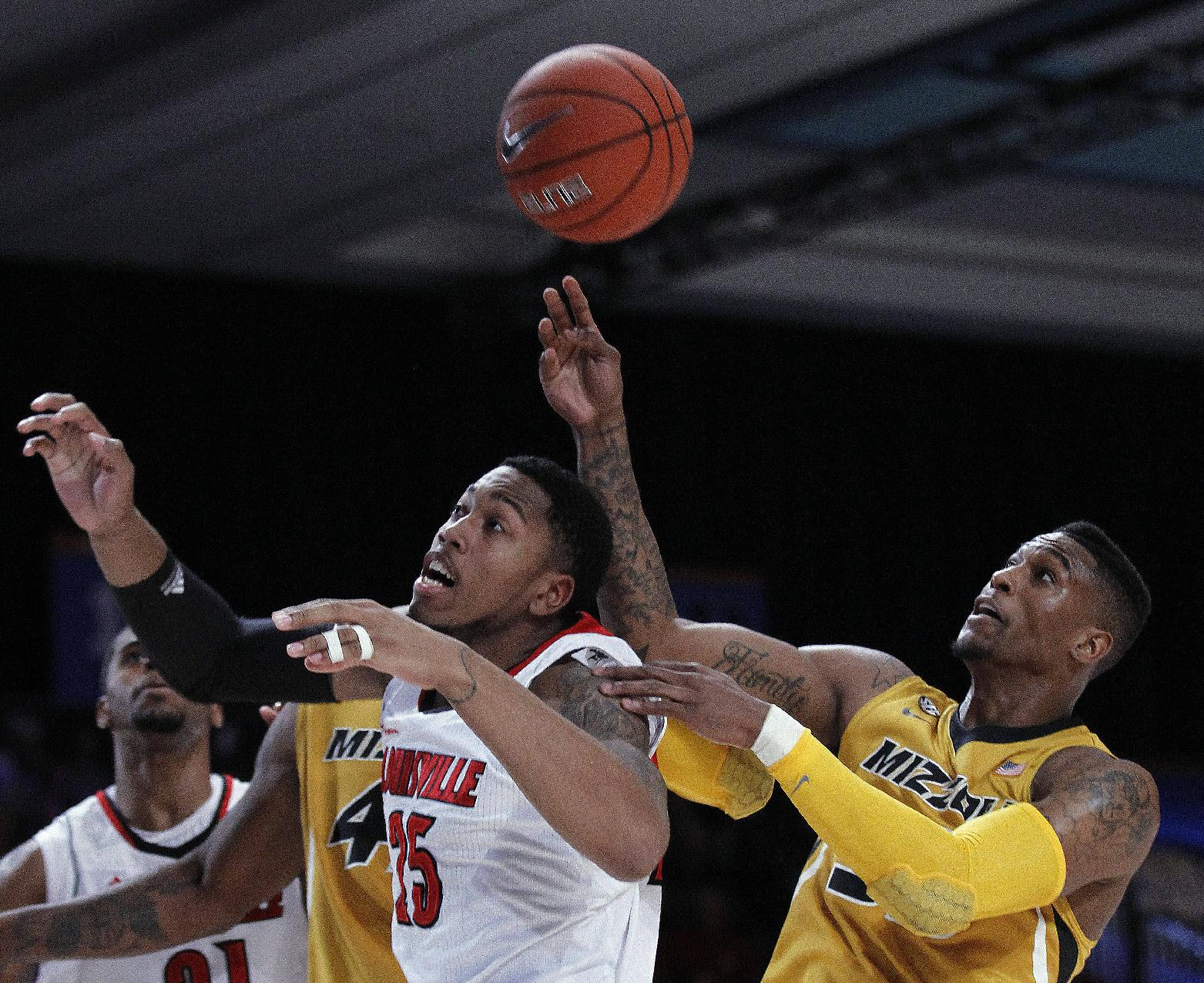 Missouri guard Earnest Ross, right, and Louisville center Zach Price (25) fight for a rebound in the first half of an NCAA college basketball game at the Battle 4 Atlantis tournament on Friday, Nov. 23, 2012, in Paradise Island, Bahamas