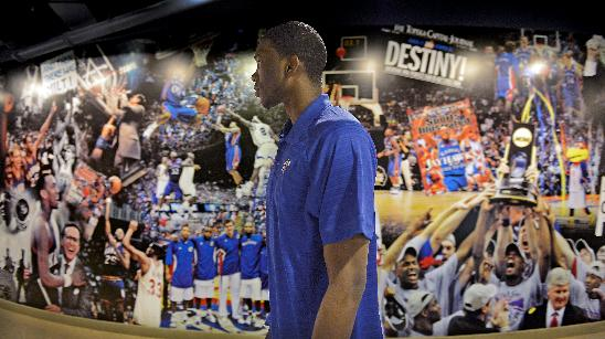 After a news conference, Kansas center Joel Embiid walks through the tunnel and onto the Allen Fieldhouse court where he then taped a private video for the university thanking Jayhawk fans and fellow students on Wednesday, April 9, 2014, in Lawrence, Kan. Embiid announced his intention to enter the NBA basketball draft