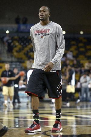 Louisville guard Kevin Ware walks off the court after warmups prior to an NCAA college basketball game against Central Florida in Orlando, Fla., Tuesday, Dec. 31, 2013