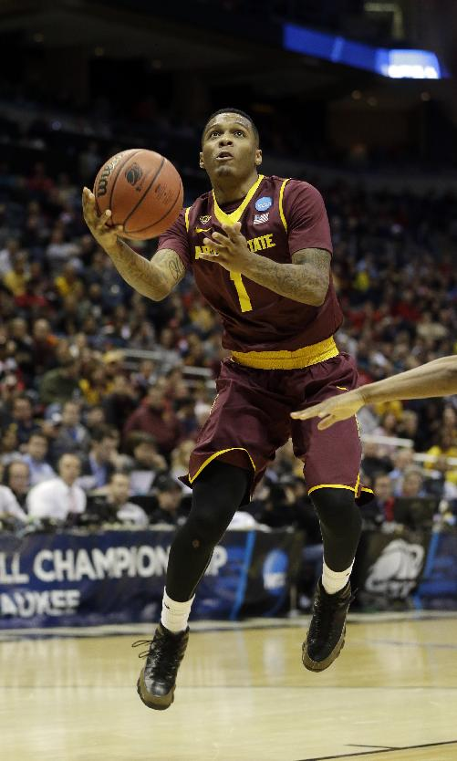 Arizona State guard Jahii Carson (1) drives to the basket during the first half of a second round NCAA college basketball tournament game against the Texas Thursday, March 20, 2014, in Milwaukee