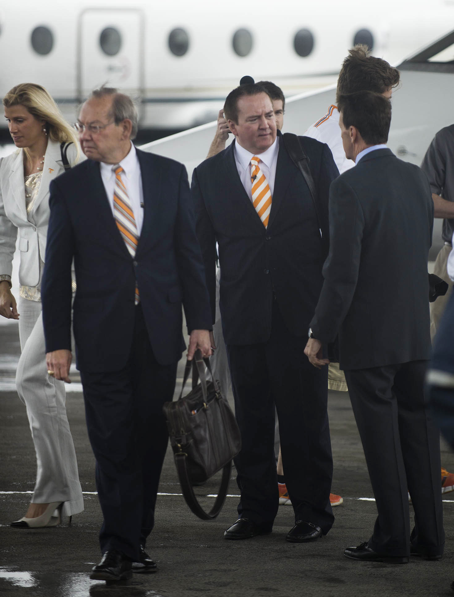Tennessee men's basketball coach Donnie Tyndall, center, talks to athletic director Dave Hart after Tyndall arrived Tuesday, April 22, 2014, in Knoxville, Tenn. At left are Tyndall's fiancee, Nikki Young, and Tennessee chancellor Jimmy Cheek. The former Southern Mississippi coach succeeds Cuonzo Martin, who resigned last week to take the coaching job at California