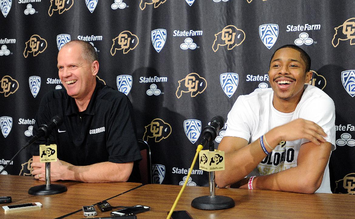 Colorado head coach Tad Boyle, left, joins Spencer Dinwiddie at a news conference on Thursday, April 24, 2014, in Boulder, Colo. Dinwiddie announced that he is skipping his senior season and will declare for the NBA draft