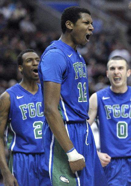 Florida Gulf Coast's Eric McKnight (12) celebrates with team mates Brett Comer (0) and Bernard Thompson (2) during the first half of a third-round game of the NCAA college basketball tournament against San Diego State, Sunday, March 24, 2013, in Philadelphia