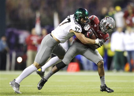 Kiko Alonso tackles Washington State's Teondray Caldwell last year. (AP)
