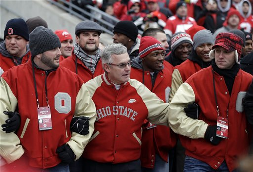 Ex-OSU coach Jim Tressel gathers with members of his '02 national championship team on Saturday . (AP)
