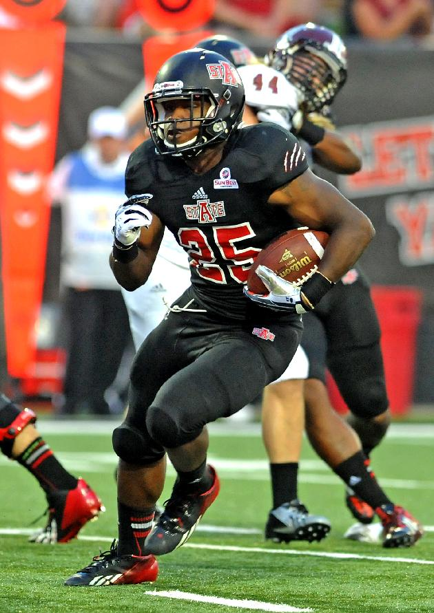 Arkansas State runnig back David Oku runs for the team's second touchdown of their NCAA college football game against Troy on Thursday, Sept. 12, 2013, in Jonesboro, Ark. Arkansas State won 41-34
