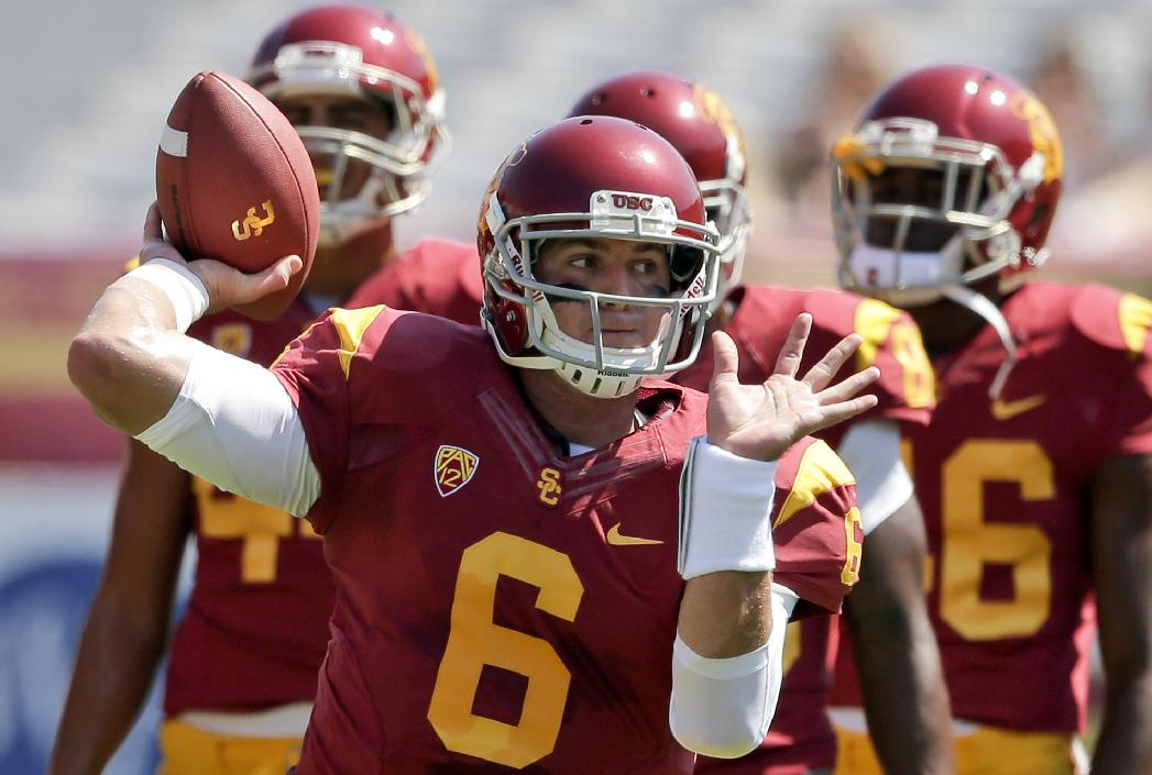 Southern California quarterback Cody Kessler warms up before an NCAA college football game against Boston College in Los Angeles, Saturday, Sept. 14, 2013