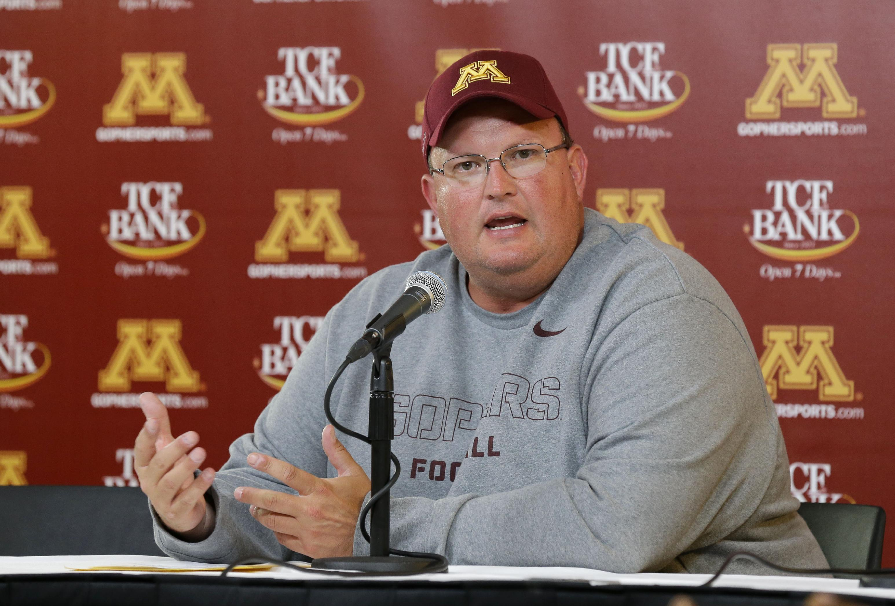 Minnesota defensive coordinator Tracy Claeys speaks during the post-game press conference after an NCAA college football game against Western Illinois in Minneapolis Saturday, Sept. 14, 2013. Head coach Jerry Kill left the game after an epileptic seizure, and Claeys, who was in the press box,  took over Kill's decision-making duties from the booth. Minnesota beat Western Illinois 29-12