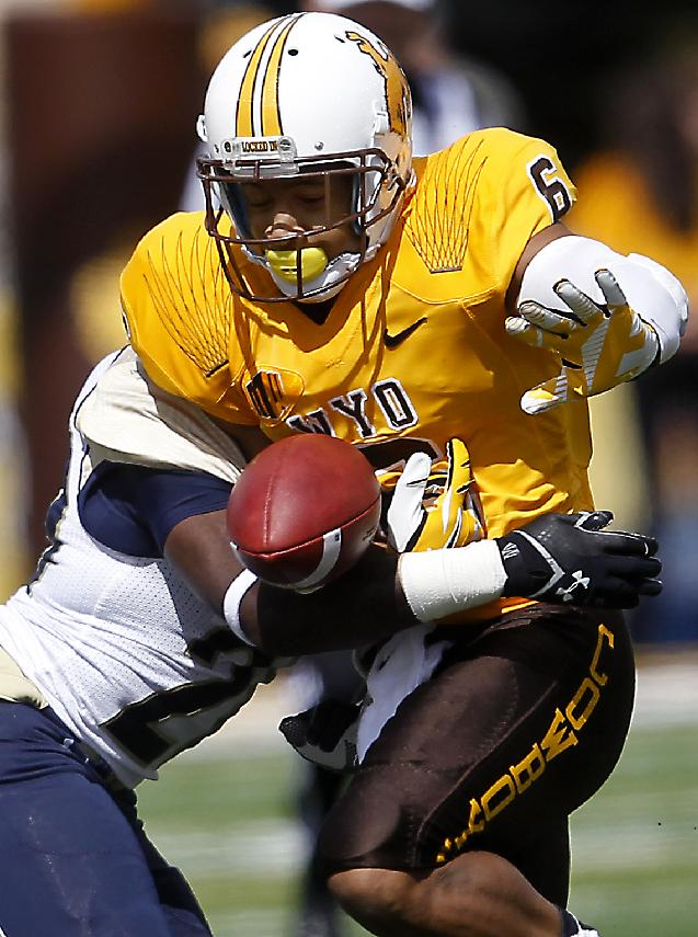 Wyoming's Robert Herron fumbles the ball against Northern Colorado during an NCAA college football game Saturday, Sept. 14, 2013, at War Memorial Stadium in Laramie, Wyo