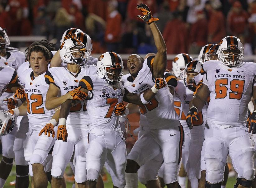 Oregon State wide receiver Brandin Cooks (7) celebrates with teammates after scoring the winning touchdown in overtime during an NCAA college football game against Utah Saturday, Sept. 14, 2013, in Salt Lake City. Oregon State defeated Utah 51-48