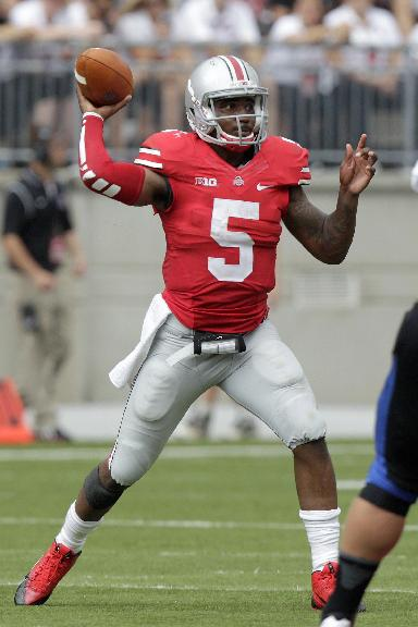 FILE-In this Saturday, Aug. 31, 2013 file photo shows Ohio State quarterback Braxton Miller playing against Buffalo during an NCAA college football game in Columbus, Ohio. There is almost no one, except for maybe a deluded fan somewhere, who believes Florida A&M has a remote chance against fourth-ranked Ohio State on Saturday. The big news around Ohio State isn't who the opponent is but rather who'll be back on the field: tailback Carlos Hyde and quarterback Braxton Miller