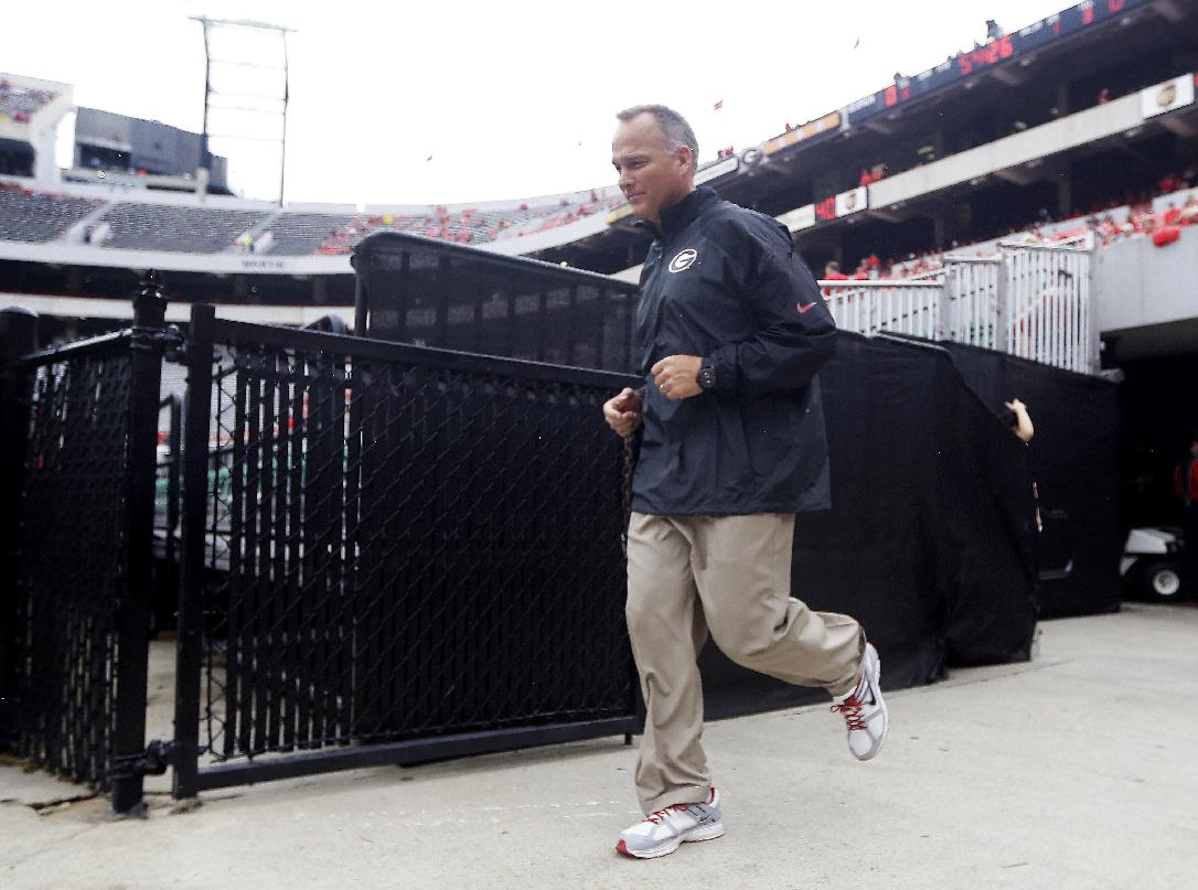 Georgia head coach Mark Richt runs out to the field as his team prepares to face North Texas in an NCAA college football game Saturday, Sept. 21, 2013 in Athens, Ga