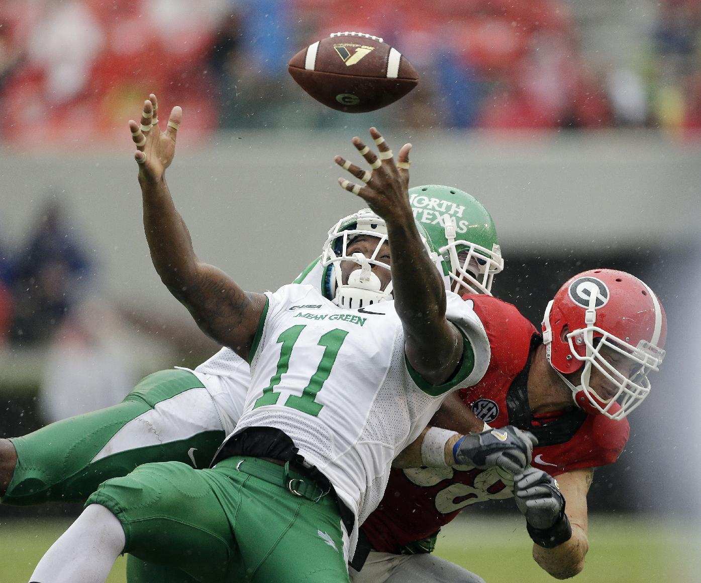 North Texas linebacker Will Wright (11) breaks up a pass intended for Georgia tight end Arthur Lynch (88) in the second half of an NCAA college football game Saturday, Sept. 21, 2013, in Athens, Ga. Georgia won 45-21