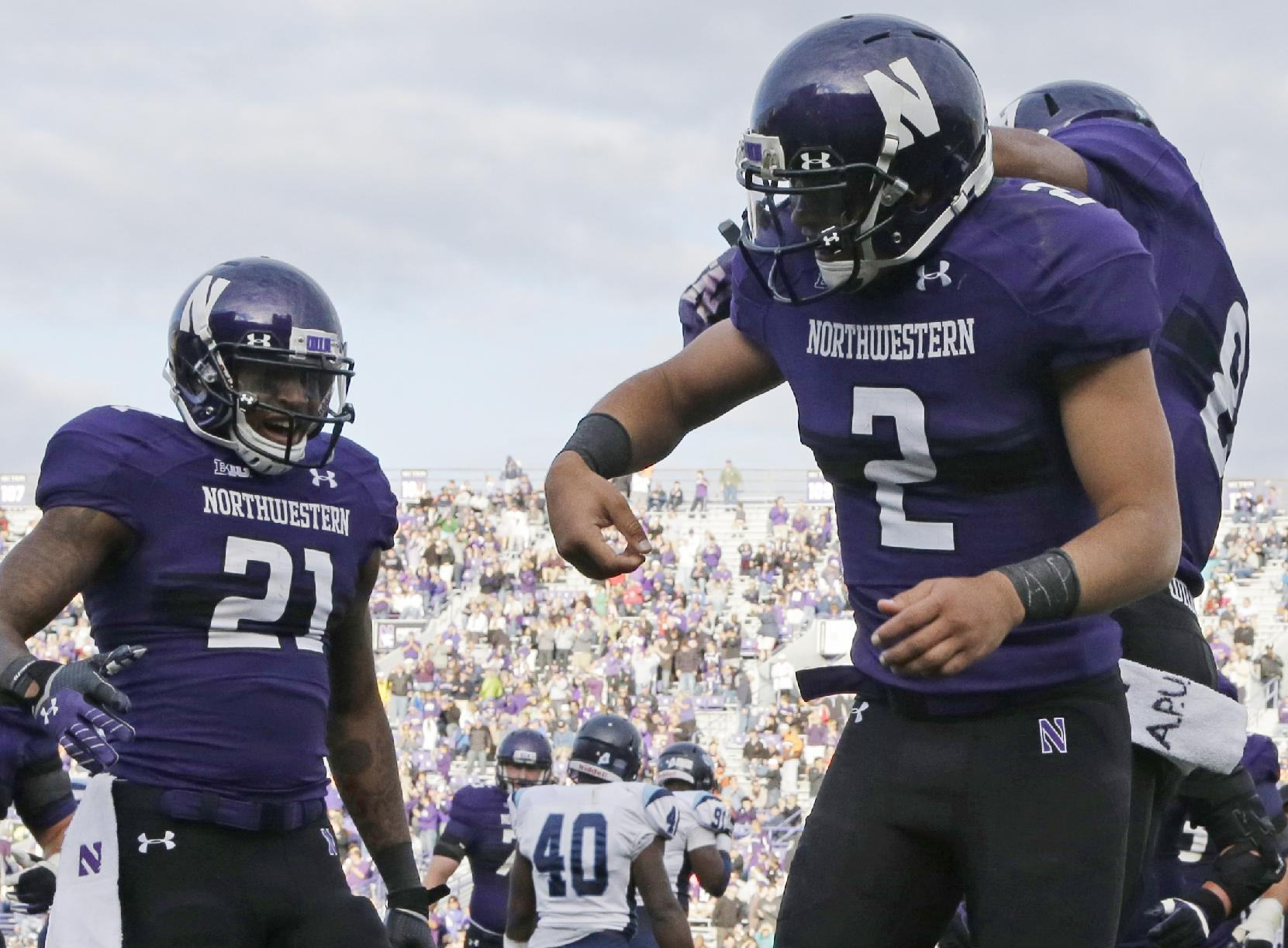 Kain Colter celebrates a TD during a Northwestern's win. (AP)