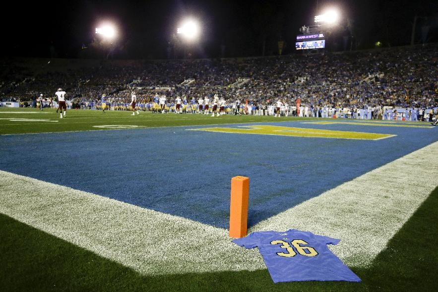 A t-shirt sits on the field honoring UCLA wide receiver Nick Pasquale before an NCAA college football game against New Mexico State Saturday, Sept. 21, 2013, in Pasadena, Calif. Pasquale was struck and killed by a car Sunday, Sept. 8, in San Clemente, Calif