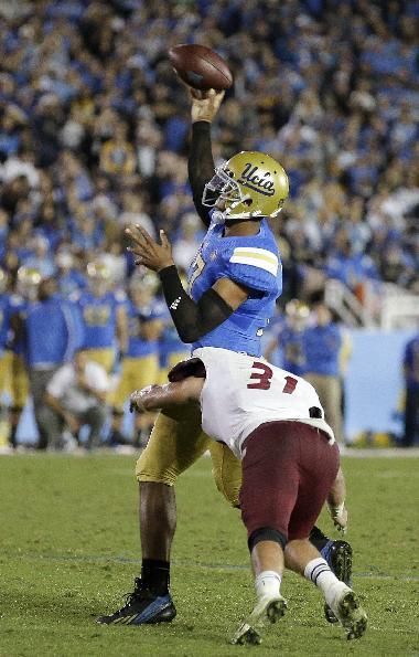 UCLA quarterback Brett Hundley throws for a touch down under pressure from New Mexico State safety Davis Cazares during the second half of an NCAA college football game Saturday, Sept. 21, 2013, in Pasadena, Calif. UCLA won 59-13