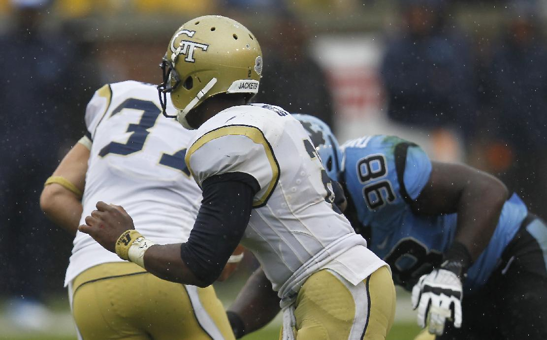 In this Sept. 21, 2013 photo, Georgia Tech quarterback Vad Lee (2) works against North Carolina during the second half of an NCAA football game in Atlanta. Lee  played with