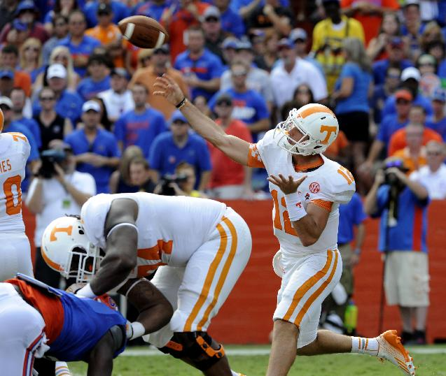 In a Sept. 21, 2013 photo, Tennessee quarterback Nathan Peterman passes against Florida during an NCAA college football game in Gainesville, Fla. Coach Butch Jones didn't name a starter for Saturday's game with South Alabama after a 31-17 loss to No. 20 Florida in which Peterman and Justin Worley each threw two interceptions