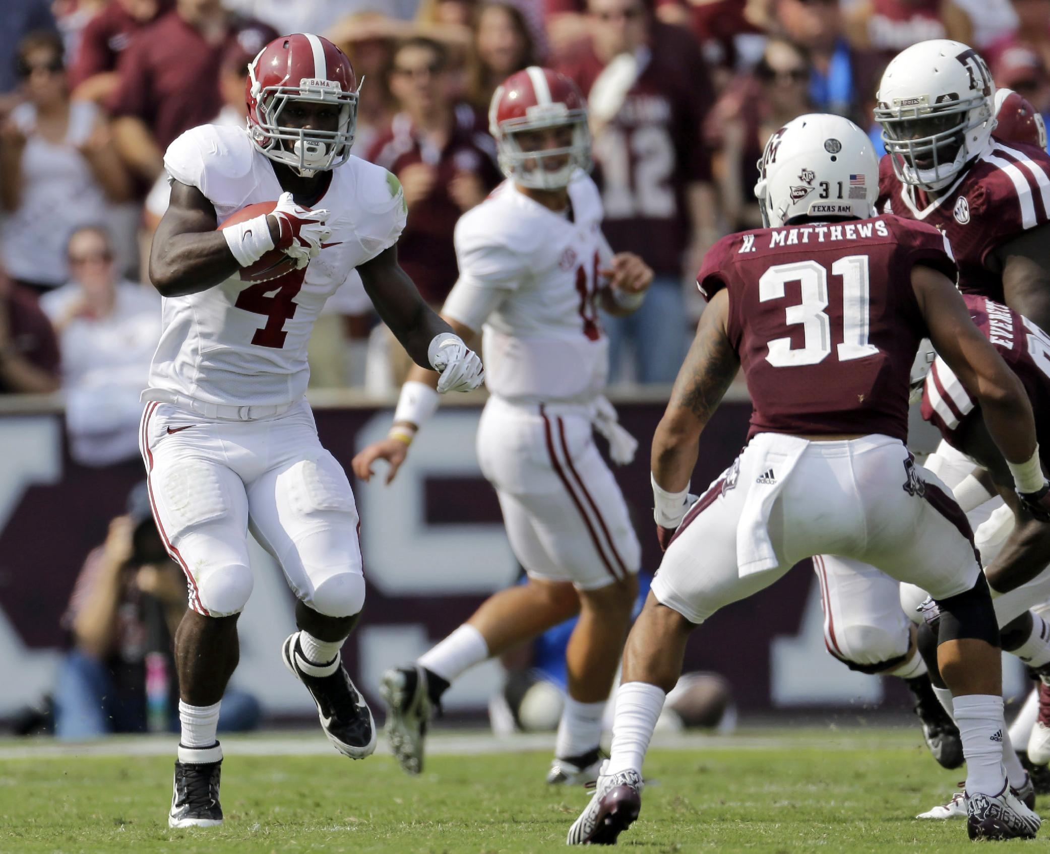 In this Sept. 14, 2013, file photo, Alabama running back T.J. Yeldon (4) rushes for a gain against Texas A&M during the second quarter of an NCAA college football game in College Station, Texas.  While Yeldon has had nifty runs and decent numbers, the top-ranked Crimson Tide's ground game ranks last in the Southeastern Conference and the offense is only one spot higher in total yards