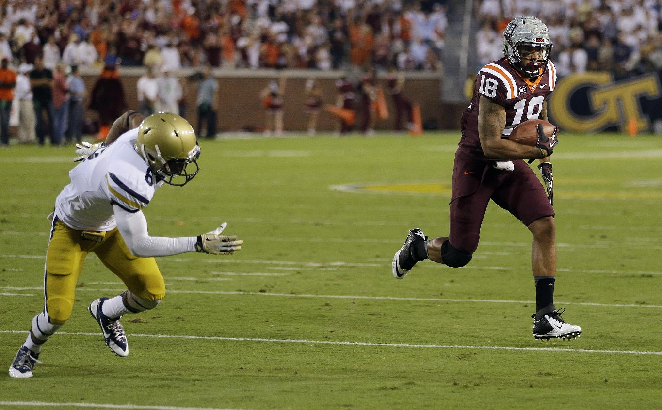 Virginia Tech wide receiver D.J. Coles (18) outruns Georgia Tech cornerback Louis Young (8) to the end zone for a touchdown in the first half of an NCAA college football game on Thursday, Sept. 26, 2013, in Atlanta