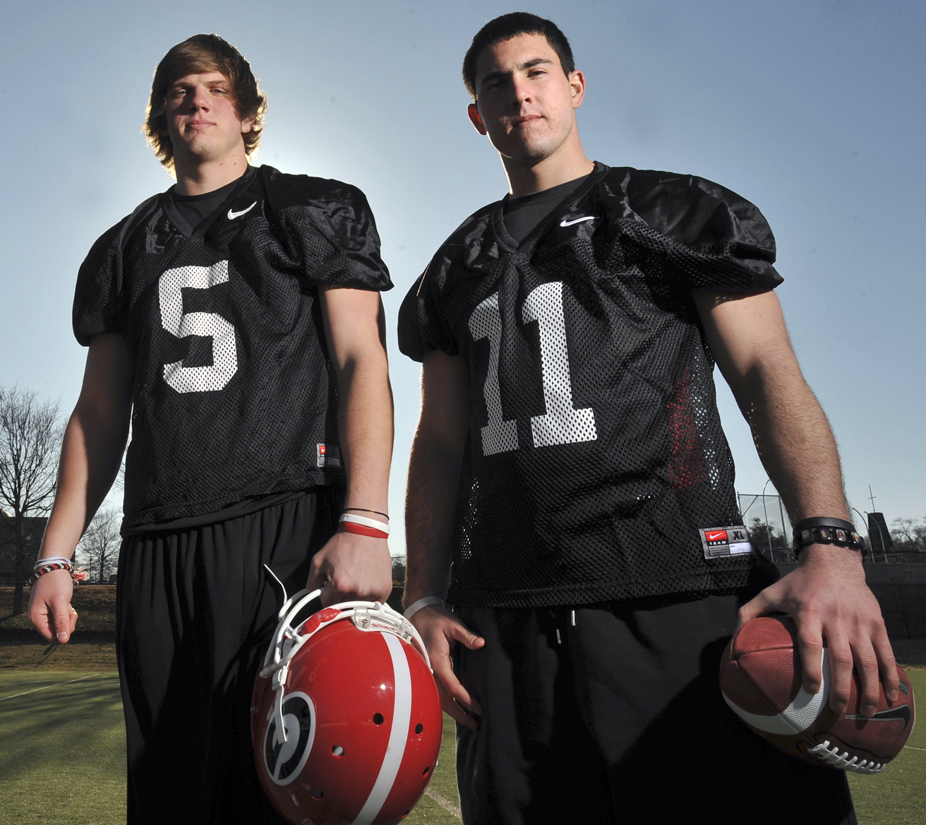 In this Feb. 26, 2010, file photo, Georgia quarterbacks Zach Mettenberger (5) and Aaron Murray (11) pose for a photo in Athens, Ga. Murray won the job, guided Georgia back to national prominence, and became the most prolific passer in school history. Mettenberger ran into legal troubles, was forced out of Athens, and landed as the starter for Southeastern Conference rival LSU. On Saturday, these former teammates will go against each other for the first time when Georgia hosts LSU