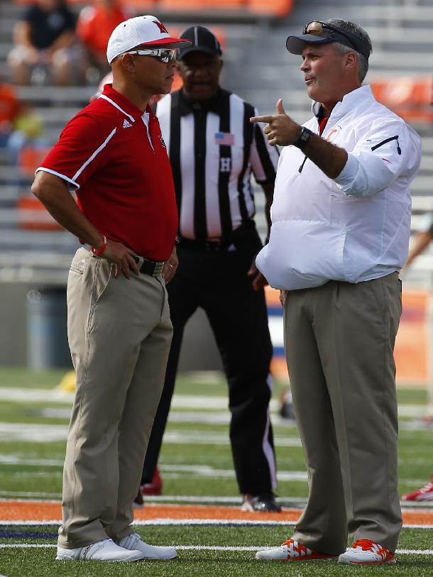 Miami (Ohio) head coach Don Treadwell. left, talks with Illinois head coach Tim Beckman before the start of an NCAA college football game on Saturday, Sept. 28, 2013, at Memorial Stadium in Champaign, Ill